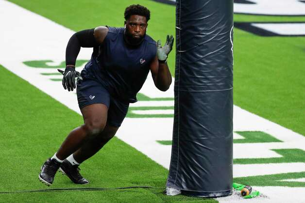 Houston Texans nose tackle Brandon Dunn warms up before an NFL football game against the Green Bay Packers at NRG Stadium on Sunday, Oct. 25, 2020, in Houston. Photo: Brett Coomer, Staff Photographer / © 2020 Houston Chronicle