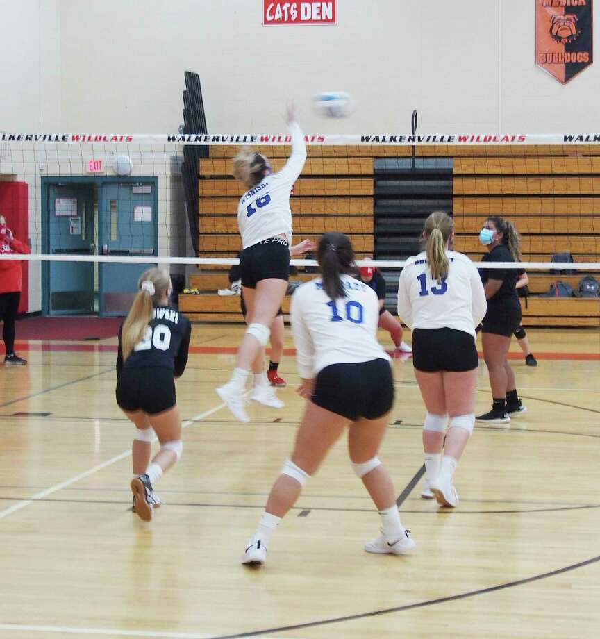 Onekama's Sophie Wisniski elevates for a kill against Walkerville on Saturday in Walkerville. (Courtesy photo)