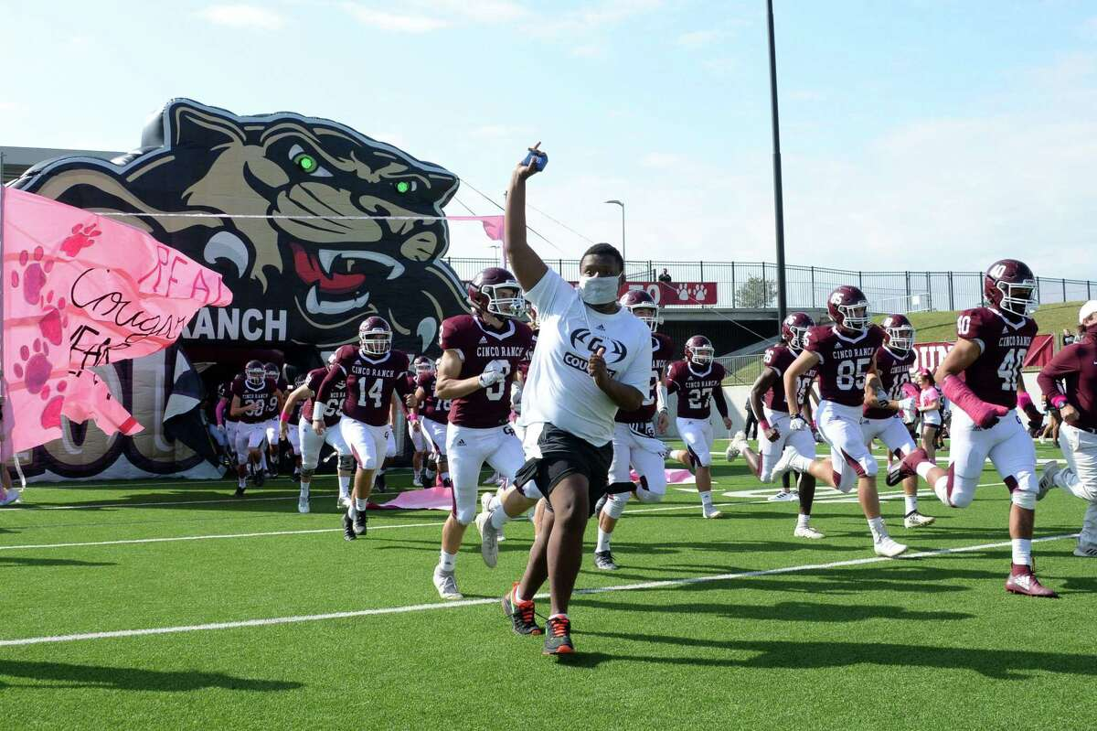The Cinco Ranch Cougars take the field for a 19-6A football game against the Katy Tigers on Saturday, October 24, 2020 at Legacy Stadium, Katy, TX.