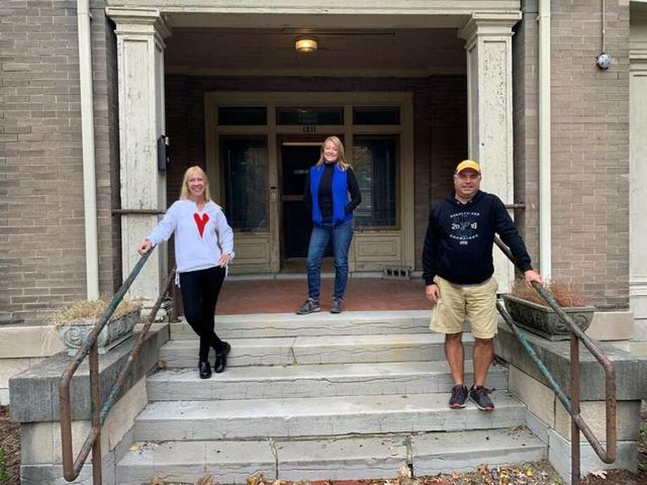 From left, Sue Utgaard, Lisa Allen and Dave Dipazo stand on the steps to the Haskell House in Alton, the planned site of a children's museum. The project is waiting approval of a permit from the city so renovations may begin.