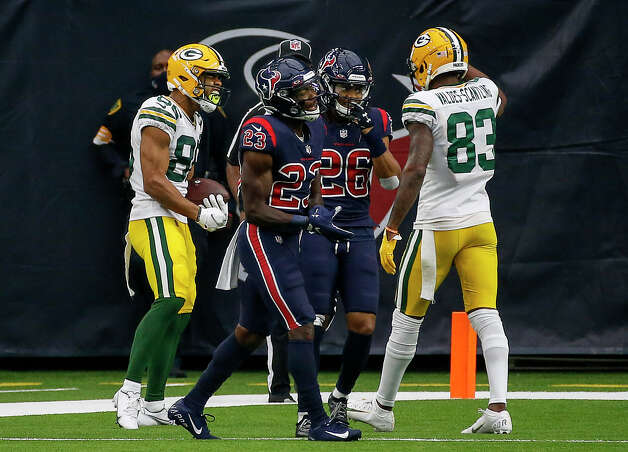 Houston Texans free safety Eric Murray (23) and cornerback Vernon Hargreaves III (26) walk off the field as Green Bay Packers wide receiver Malik Taylor (86) celebrates after scoring a touchdown during the second quarter of an NFL game Sunday, Oct. 25, 2020, at NRG Stadium in Houston. Photo: Jon Shapley, Staff Photographer / © 2020 Houston Chronicle