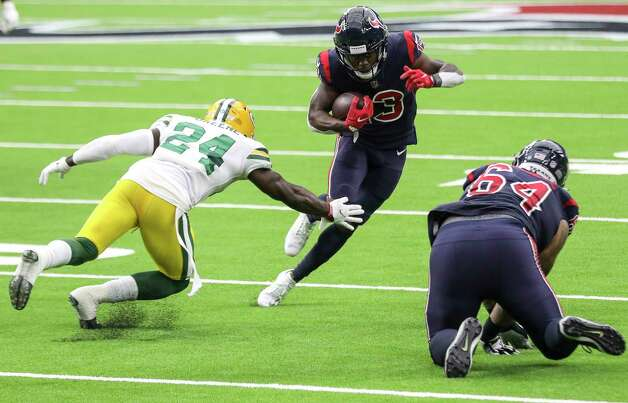 Houston Texans wide receiver Brandin Cooks (13) breaks a tackle by Green Bay Packers safety Raven Greene (24) as Houston Texans offensive guard Senio Kelemete (64) stumbles during the second quarter of an NFL game Sunday, Oct. 25, 2020, at NRG Stadium in Houston. Photo: Jon Shapley, Staff Photographer / © 2020 Houston Chronicle