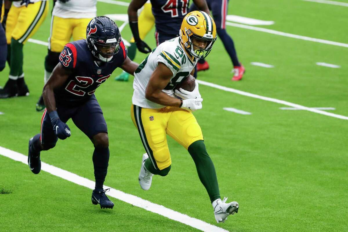Green Bay Packers wide receiver Malik Taylor (86) beats Houston Texans free safety Eric Murray (23) into the end zone for a 1-yard touchdown reception during the second quarter of an NFL football game at NRG Stadium on Sunday, Oct. 25, 2020, in Houston.