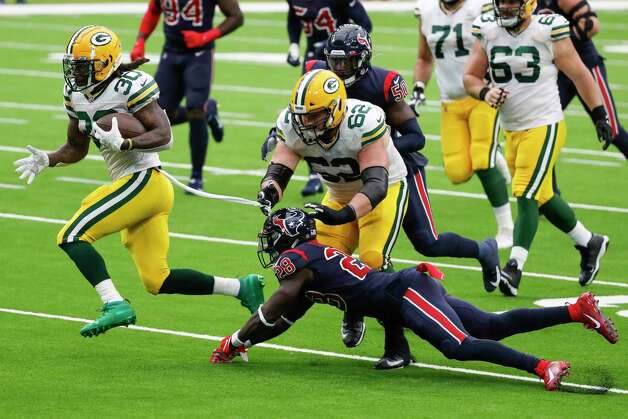 Green Bay Packers running back Jamaal Williams (30) breaks away from Houston Texans defensive back Michael Thomas (28) for a first down reception during the second quarter of an NFL football game at NRG Stadium on Sunday, Oct. 25, 2020, in Houston. Photo: Brett Coomer, Staff Photographer / © 2020 Houston Chronicle