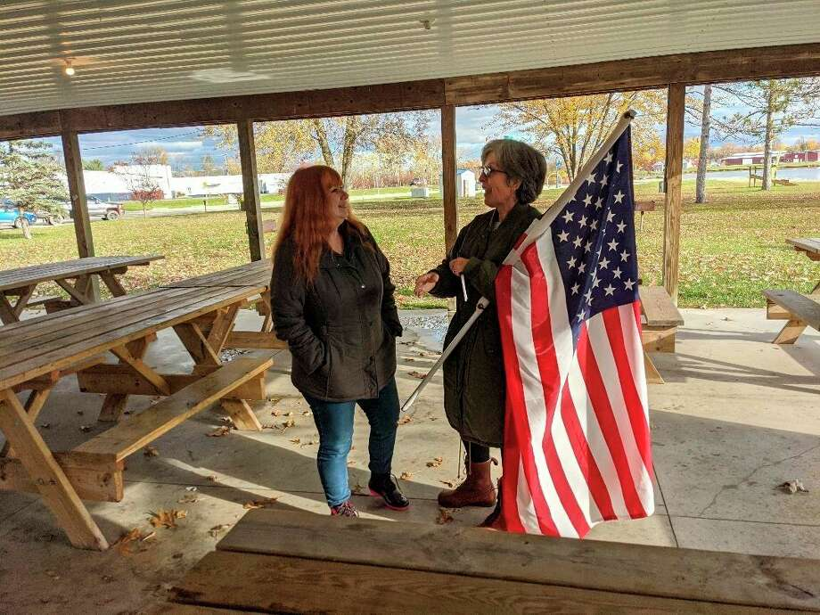 Annette Murray, left, and Mary Moylan talk about constitutional issues at Beaverton's Ross Lake Park where a freedom march and petition to restore freedom circulated on Saturday. (Photo by Tereasa Nims for the Daily News)