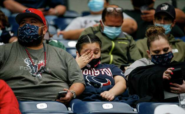A Houston Texans fan rubs her eye during the second quarter of an NFL game Sunday, Oct. 25, 2020, at NRG Stadium in Houston. Photo: Jon Shapley, Staff Photographer / © 2020 Houston Chronicle