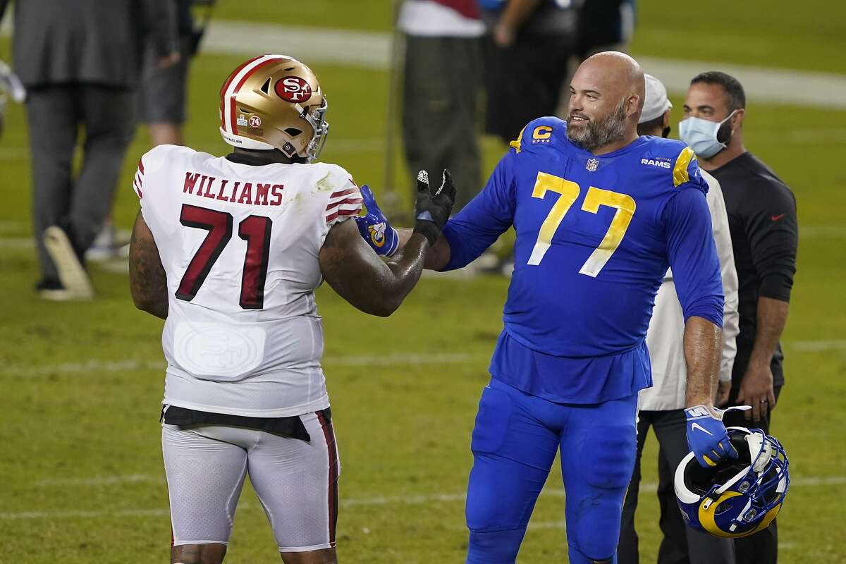 San Francisco 49ers offensive tackle Trent Williams (71) greets Los Angeles Rams offensive tackle Andrew Whitworth (77) after an NFL football game in Santa Clara, Calif., Sunday, Oct. 18, 2020. (AP Photo/Tony Avelar)