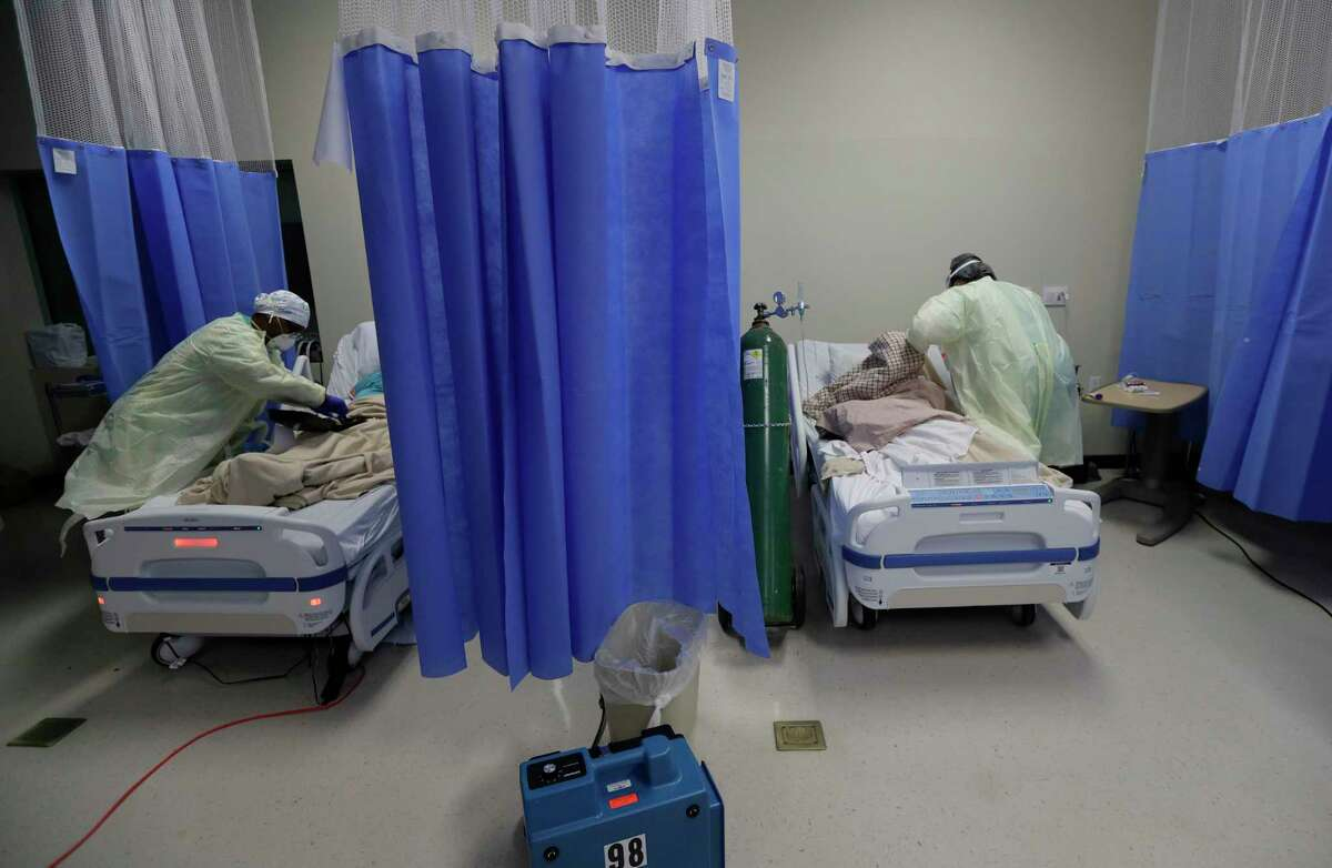 Medical personnel watch over COVID-19 patients at DHR Health, Wednesday, July 29, 2020, in McAllen, Texas. (AP Photo/Eric Gay)