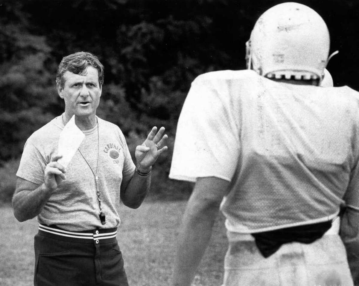 Greenwich coach Mike Ornato gives some tips to his running backs in 1985. Ornato went 210-50-7 at Greenwich High, winning seven FCIAC and four state titles.