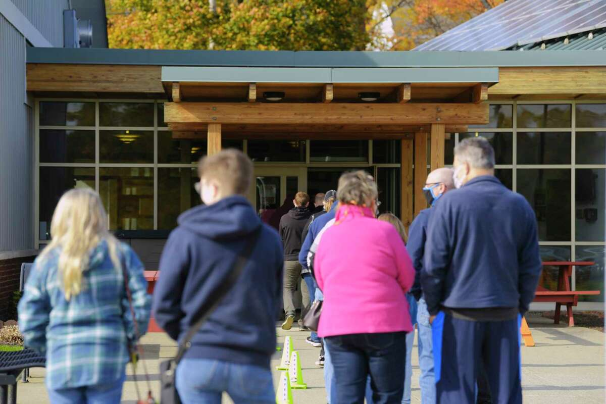 Voters wait in line outside the Brunswick Town offices for early voting on Sunday, Oct. 25, 2020, in Brunswick, N.Y. (Paul Buckowski/Times Union)