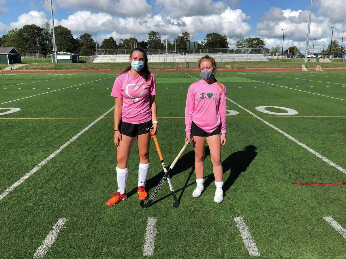 Guilford field hockey captains Hannah Tillier, left, and Madden Cunningham participated in the team's car wash fundraiser for Play4TheCure.