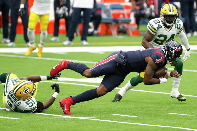 Houston Texans quarterback Deshaun Watson (4) is tripped up by Green Bay Packers inside linebacker Krys Barnes (51) after Watson was forced to scramble out of the pocket during the second quarter of an NFL football game at NRG Stadium on Sunday, Oct. 25, 2020, in Houston. Photo: Brett Coomer, Staff Photographer / © 2020 Houston Chronicle