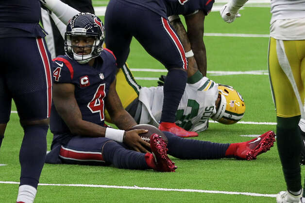 Houston Texans quarterback Deshaun Watson (4) sits on the field after being sacked by Green Bay Packers strong safety Adrian Amos (31) during the fourth quarter of an NFL game Sunday, Oct. 25, 2020, at NRG Stadium in Houston. Photo: Jon Shapley, Staff Photographer / © 2020 Houston Chronicle