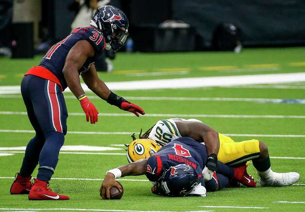 Houston Texans quarterback Deshaun Watson (4) reaches forward with the ball as he is tackled by Green Bay Packers outside linebacker Za'Darius Smith (55) during the fourth quarter of an NFL game Sunday, Oct. 25, 2020, at NRG Stadium in Houston. Photo: Jon Shapley, Staff Photographer / © 2020 Houston Chronicle