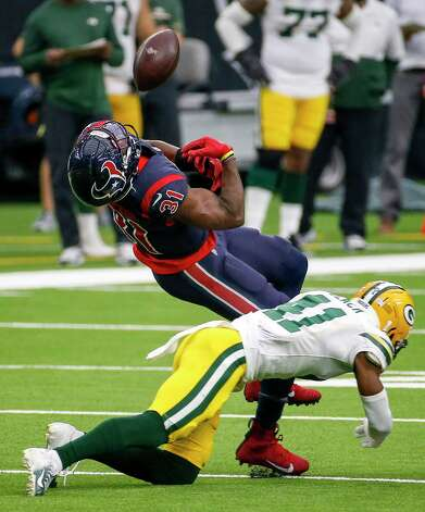 Houston Texans running back David Johnson (31) fumbles the ball after a reception as he is hit by Green Bay Packers safety Henry Black (41) during the fourth quarter of an NFL game Sunday, Oct. 25, 2020, at NRG Stadium in Houston. Photo: Jon Shapley, Staff Photographer / © 2020 Houston Chronicle