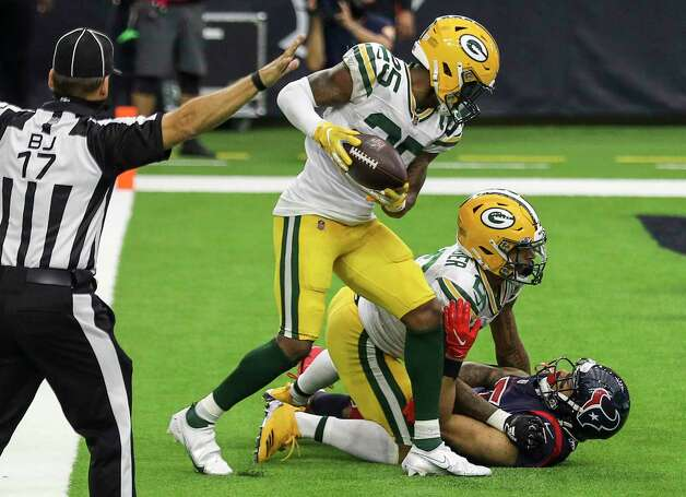 Green Bay Packers safety Will Redmond (25) and cornerback Jaire Alexander (23) look at Houston Texans wide receiver Will Fuller (15) after he missed a touchdown pass during the fourth quarter of an NFL game Sunday, Oct. 25, 2020, at NRG Stadium in Houston. Photo: Jon Shapley, Staff Photographer / © 2020 Houston Chronicle