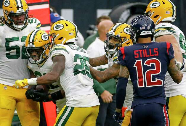 Green Bay Packers players celebrate after Green Bay Packers strong safety Adrian Amos (31) recovered a fumble by Houston Texans running back David Johnson (31) during the fourth quarter of an NFL game Sunday, Oct. 25, 2020, at NRG Stadium in Houston. Photo: Jon Shapley, Staff Photographer / © 2020 Houston Chronicle