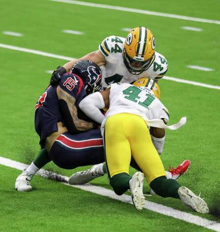 Houston Texans wide receiver Will Fuller (15) gets past Green Bay Packers safety Henry Black (41) and linebacker Ty Summers (44) to score a touchdown during the fourth quarter of an NFL game Sunday, Oct. 25, 2020, at NRG Stadium in Houston. Photo: Jon Shapley, Staff Photographer / © 2020 Houston Chronicle