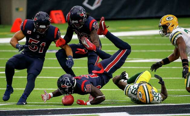 Houston Texans defensive back Michael Thomas (28) recovers an onside kick as Houston Texans linebacker Dylan Cole (51) and cornerback Lonnie Johnson (32), Green Bay Packers cornerback Chandon Sullivan (39) and strong safety Adrian Amos (31) also go after the ball during the fourth quarter of an NFL game Sunday, Oct. 25, 2020, at NRG Stadium in Houston. Photo: Jon Shapley, Staff Photographer / © 2020 Houston Chronicle