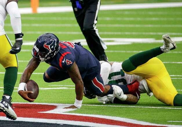 Houston Texans quarterback Deshaun Watson (4) is sacked by Green Bay Packers outside linebacker Preston Smith (91) during the fourth quarter of an NFL game Sunday, Oct. 25, 2020, at NRG Stadium in Houston. Photo: Jon Shapley, Staff Photographer / © 2020 Houston Chronicle