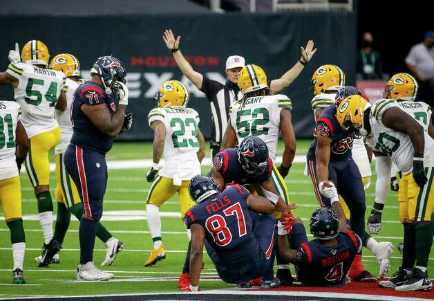 Houston Texans quarterback Deshaun Watson (4) is helped up by wide receiver Randall Cobb (18), tight end Pharaoh Brown (85) and Green Bay Packers defensive tackle Montravius Adams (90) after he was sacked during the fourth quarter of an NFL game Sunday, Oct. 25, 2020, at NRG Stadium in Houston. Photo: Jon Shapley, Staff Photographer / © 2020 Houston Chronicle