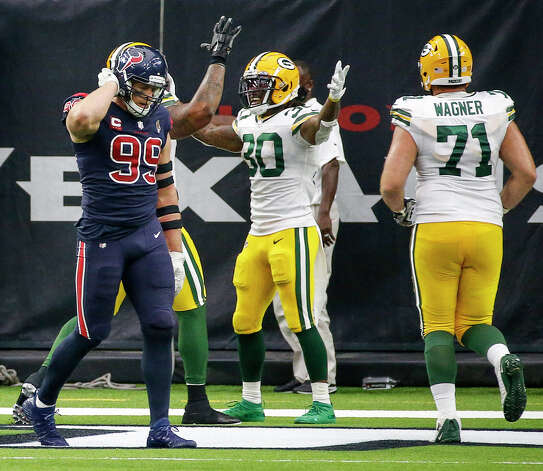 Houston Texans defensive end J.J. Watt (99) leaves teh field as Green Bay Packers running back Jamaal Williams (30) celebrates with teammates after scoring a touchdown during the fourth quarter of an NFL game Sunday, Oct. 25, 2020, at NRG Stadium in Houston. Photo: Jon Shapley, Staff Photographer / © 2020 Houston Chronicle