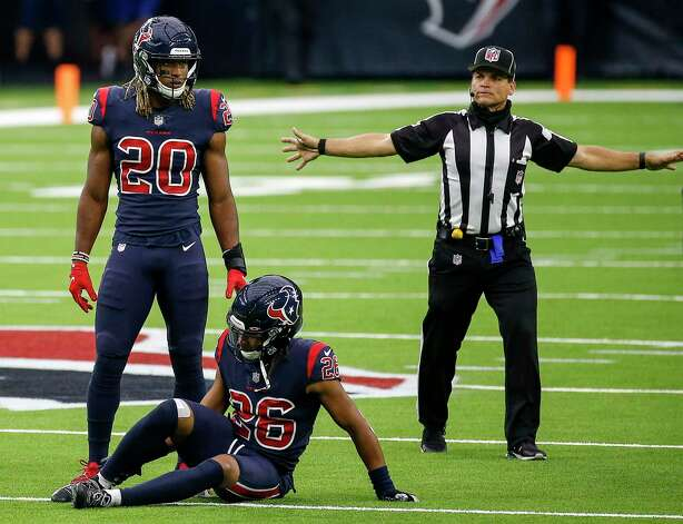 Houston Texans cornerback Vernon Hargreaves III (26) sits on the field as strong safety Justin Reid (20) stands near him during the fourth quarter of an NFL game Sunday, Oct. 25, 2020, at NRG Stadium in Houston. Photo: Jon Shapley, Staff Photographer / © 2020 Houston Chronicle