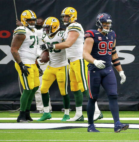 Houston Texans defensive end J.J. Watt (99) walks off the field as Green Bay Packers offensive guard Elgton Jenkins (74), running back Jamaal Williams (30) and offensive tackle Rick Wagner (71) celebrate a touchdown by Williams during the fourth quarter of an NFL game Sunday, Oct. 25, 2020, at NRG Stadium in Houston. Photo: Jon Shapley, Staff Photographer / © 2020 Houston Chronicle