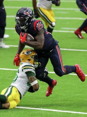 Houston Texans running back Duke Johnson (25) is brought down by Green Bay Packers defensive back Vernon Scott (36) during the fourth quarter of an NFL game Sunday, Oct. 25, 2020, at NRG Stadium in Houston. Photo: Jon Shapley, Staff Photographer / © 2020 Houston Chronicle