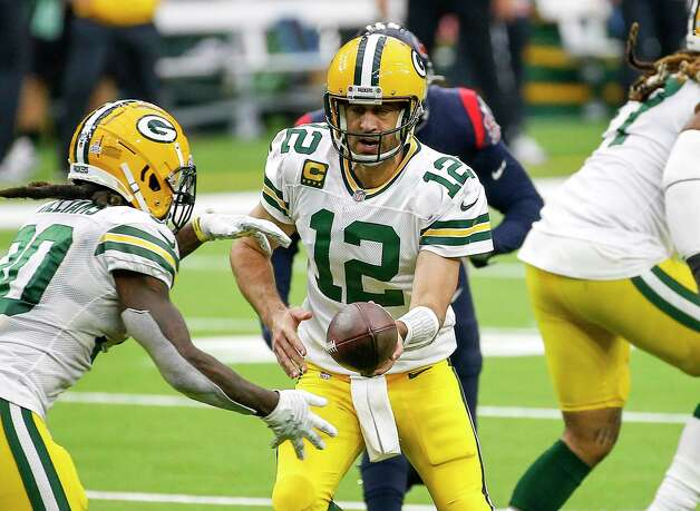 Green Bay Packers quarterback Aaron Rodgers (12) hands off the ball to running back Jamaal Williams (30) during the fourth quarter of an NFL game Sunday, Oct. 25, 2020, at NRG Stadium in Houston. Photo: Jon Shapley, Staff Photographer / © 2020 Houston Chronicle