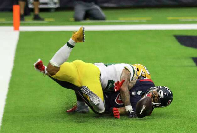 Houston Texans wide receiver Will Fuller (15) watches the ball land after he missed a touchdown pass defended by Green Bay Packers cornerback Jaire Alexander (23) during the fourth quarter of an NFL game Sunday, Oct. 25, 2020, at NRG Stadium in Houston. Photo: Jon Shapley, Staff Photographer / © 2020 Houston Chronicle
