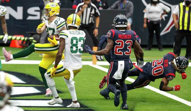 Green Bay Packers tight end Jace Sternberger (87) runs into the end zone past Houston Texans free safety Eric Murray (23) and strong safety Justin Reid (20) for a 3-yard touchdown reception for a during the first half of an NFL football game at NRG Stadium on Sunday, Oct. 25, 2020, in Houston. Photo: Brett Coomer, Staff Photographer / © 2020 Houston Chronicle