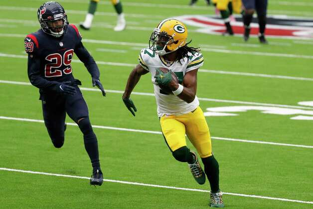 Green Bay Packers wide receiver Davante Adams (17) turns upfield after making a catch against Houston Texans cornerback Phillip Gaines (29) during the second quarter of an NFL football game at NRG Stadium on Sunday, Oct. 25, 2020, in Houston. Photo: Brett Coomer, Staff Photographer / © 2020 Houston Chronicle