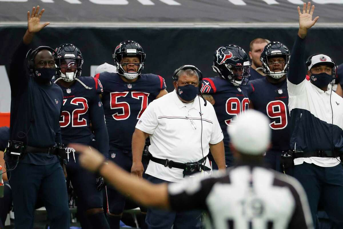 Houston Texans interim head coach Romeo Crennel watches referee Clay Martin make a call during the first half of an NFL football game against the Green Bay Packers at NRG Stadium on Sunday, Oct. 25, 2020, in Houston.
