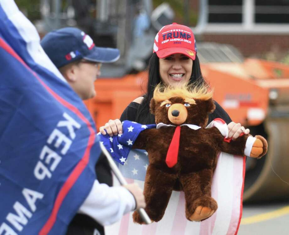 Darien's Erika Gardner holds a Trump bear during the Trump 2020/Back the Blue rally in Greenwich, Conn. Sunday, Oct. 25, 2020. Hundreds of Donald Trump supporters rallied together to how support for the president's re-election bid in the Island Beach parking lot before caravaning north together on I-95. Photo: Tyler Sizemore / Hearst Connecticut Media / Greenwich Time