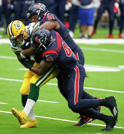 Houston Texans defensive end Carlos Watkins (91) and inside linebacker Zach Cunningham (41) stop Green Bay Packers running back A.J. Dillon (28) at the line of scrimmages during the first half of an NFL football game at NRG Stadium on Sunday, Oct. 25, 2020, in Houston. Photo: Brett Coomer, Staff Photographer / © 2020 Houston Chronicle