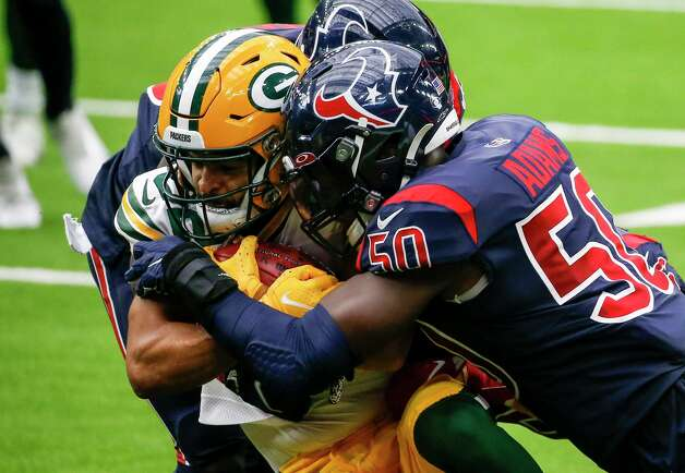 Green Bay Packers wide receiver Darrius Shepherd (82) is tackled by Houston Texans cornerback Keion Crossen (35) and linebacker Tyrell Adams (50) during the second quarter of an NFL game Sunday, Oct. 25, 2020, at NRG Stadium in Houston. Photo: Jon Shapley, Staff Photographer / © 2020 Houston Chronicle
