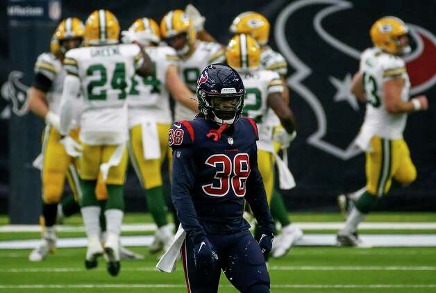 Houston Texans running back Buddy Howell (38) walks off the field as Green Bay Packers players celebrate after bringing the ball down on the 2-yard line following a punt during the second quarter of an NFL game Sunday, Oct. 25, 2020, at NRG Stadium in Houston. Photo: Jon Shapley, Staff Photographer / © 2020 Houston Chronicle