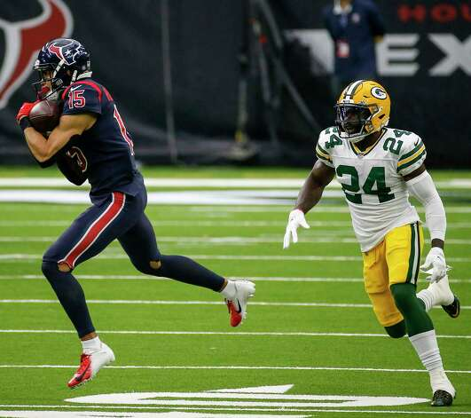 Houston Texans wide receiver Will Fuller (15) catches a pass defended by Green Bay Packers safety Raven Greene (24) during the second quarter of an NFL game Sunday, Oct. 25, 2020, at NRG Stadium in Houston. Photo: Jon Shapley, Staff Photographer / © 2020 Houston Chronicle