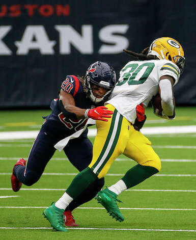 Houston Texans strong safety Justin Reid (20) tackles Green Bay Packers running back Jamaal Williams (30) during the second quarter of an NFL game Sunday, Oct. 25, 2020, at NRG Stadium in Houston. Photo: Jon Shapley, Staff Photographer / © 2020 Houston Chronicle