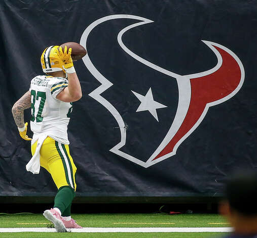 Green Bay Packers tight end Jace Sternberger (87) throws the ball at a Houston Texans logo after scoring a touchdown during the second quarter of an NFL game Sunday, Oct. 25, 2020, at NRG Stadium in Houston. Photo: Jon Shapley, Staff Photographer / © 2020 Houston Chronicle
