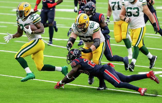 Green Bay Packers running back Jamaal Williams (30) breaks away from Houston Texans defensive back Michael Thomas (28) for a first down reception during the first half of an NFL football game at NRG Stadium on Sunday, Oct. 25, 2020, in Houston. Photo: Brett Coomer, Staff Photographer / © 2020 Houston Chronicle