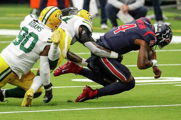 Houston Texans quarterback Deshaun Watson (4) was sacked by the Green Bay Packers during the first half of an NFL football game at NRG Stadium on Sunday, Oct. 25, 2020, in Houston. Photo: Brett Coomer, Staff Photographer / © 2020 Houston Chronicle