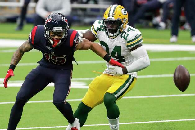 Green Bay Packers safety Raven Greene (24) breaks up a pass intended for Houston Texans wide receiver Will Fuller (15) during the first half of an NFL football game at NRG Stadium on Sunday, Oct. 25, 2020, in Houston. Photo: Brett Coomer, Staff Photographer / © 2020 Houston Chronicle