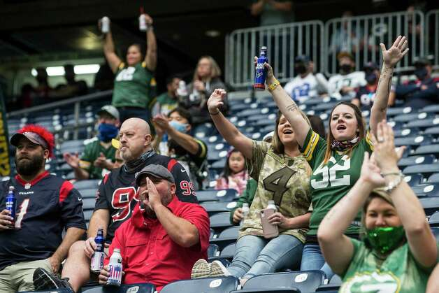 Green Bay Packers fans cheer after the Packers scored against the Houston Texans during an NFL football game at NRG Stadium on Sunday, Oct. 25, 2020, in Houston. Photo: Brett Coomer, Staff Photographer / © 2020 Houston Chronicle
