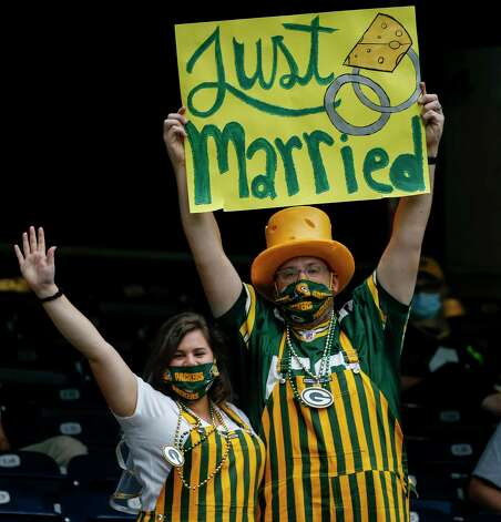 Green Bay Packers fans pose for a photo during the second quarter of an NFL game Sunday, Oct. 25, 2020, at NRG Stadium in Houston. Photo: Jon Shapley, Staff Photographer / © 2020 Houston Chronicle