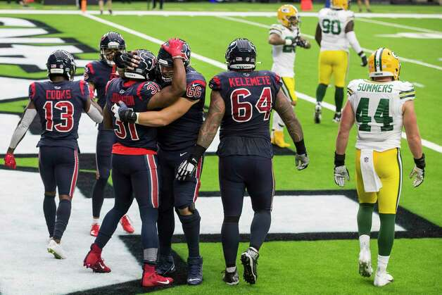 Houston Texans running back David Johnson (31) embraces center Nick Martin (66) after Johnson scored on a 3-yard touchdown reception against the Green Bay Packers during an NFL football game at NRG Stadium on Sunday, Oct. 25, 2020, in Houston. Photo: Brett Coomer, Staff Photographer / © 2020 Houston Chronicle