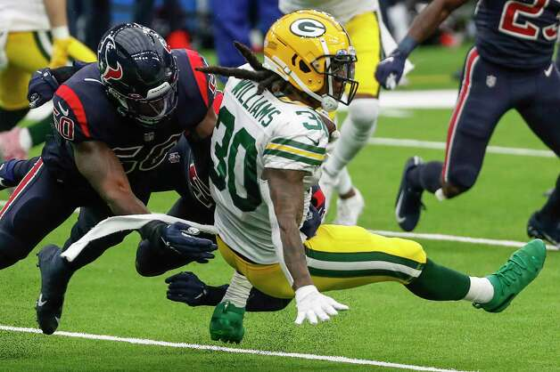 Houston Texans linebacker Tyrell Adams (50) stops Green Bay Packers running back Jamaal Williams (30) during the second half an NFL football game at NRG Stadium on Sunday, Oct. 25, 2020, in Houston. Photo: Brett Coomer, Staff Photographer / © 2020 Houston Chronicle