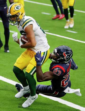 Green Bay Packers wide receiver Malik Taylor (86) beats Houston Texans free safety Eric Murray (23) into the end zone for a 1-yard touchdown reception during the first half of an NFL football game at NRG Stadium on Sunday, Oct. 25, 2020, in Houston. Photo: Brett Coomer, Staff Photographer / © 2020 Houston Chronicle