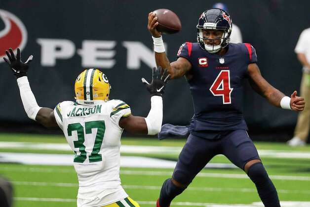 Houston Texans quarterback Deshaun Watson (4) is chased out of bounds by Green Bay Packers cornerback Josh Jackson (37) during the second half an NFL football game at NRG Stadium on Sunday, Oct. 25, 2020, in Houston. Photo: Brett Coomer, Staff Photographer / © 2020 Houston Chronicle